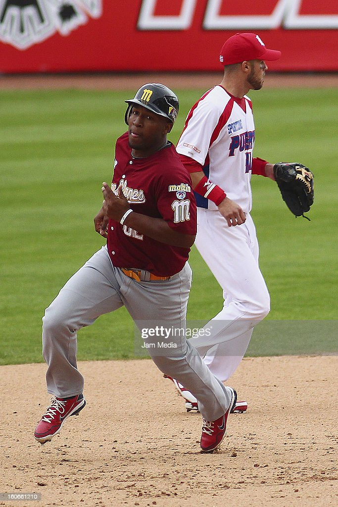 <a gi-track='captionPersonalityLinkClicked' href=/galleries/search?phrase=Jose+Castillo&family=editorial&specificpeople=216394 ng-click='$event.stopPropagation()'>Jose Castillo</a>n (L) of Venezuela in action during the Caribbean Series 2013 at Sonora Stadium on February 03, 2013 in Hermosillo, Mexico.