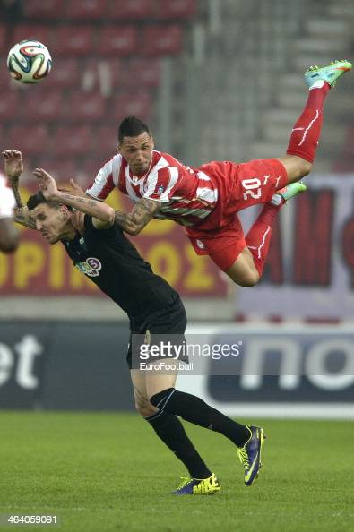 Jose Cholebas of Olympiacos challenges for the ball with Vangelis Matzios of Levadiakos during the Greek Superleague match between Olympiacos and...