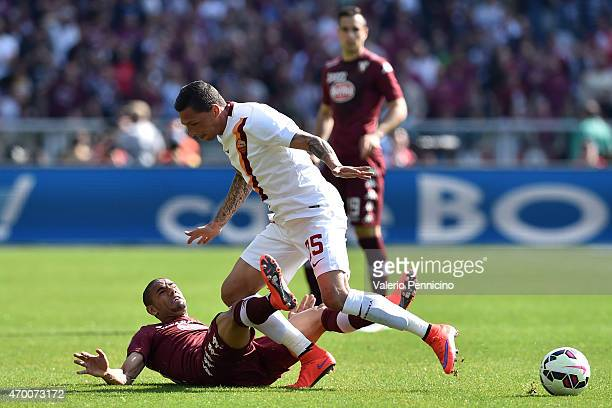 Jose Cholevas of AS Roma is tackled by Bruno Peres of Torino FC during the Serie A match between Torino FC and AS Roma at Stadio Olimpico di Torino...