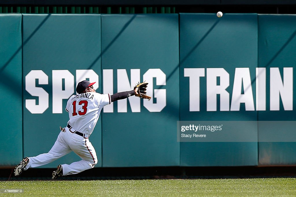 <a gi-track='captionPersonalityLinkClicked' href=/galleries/search?phrase=Jose+Constanza&family=editorial&specificpeople=7471312 ng-click='$event.stopPropagation()'>Jose Constanza</a> #13 of the Atlanta Braves is unable to field a fly ball in the ninth inning of a game against the Tampa Bay Rays at Champion Stadium on March 14, 2014 in Lake Buena Vista, Florida. Atlanta won the game 6-1.