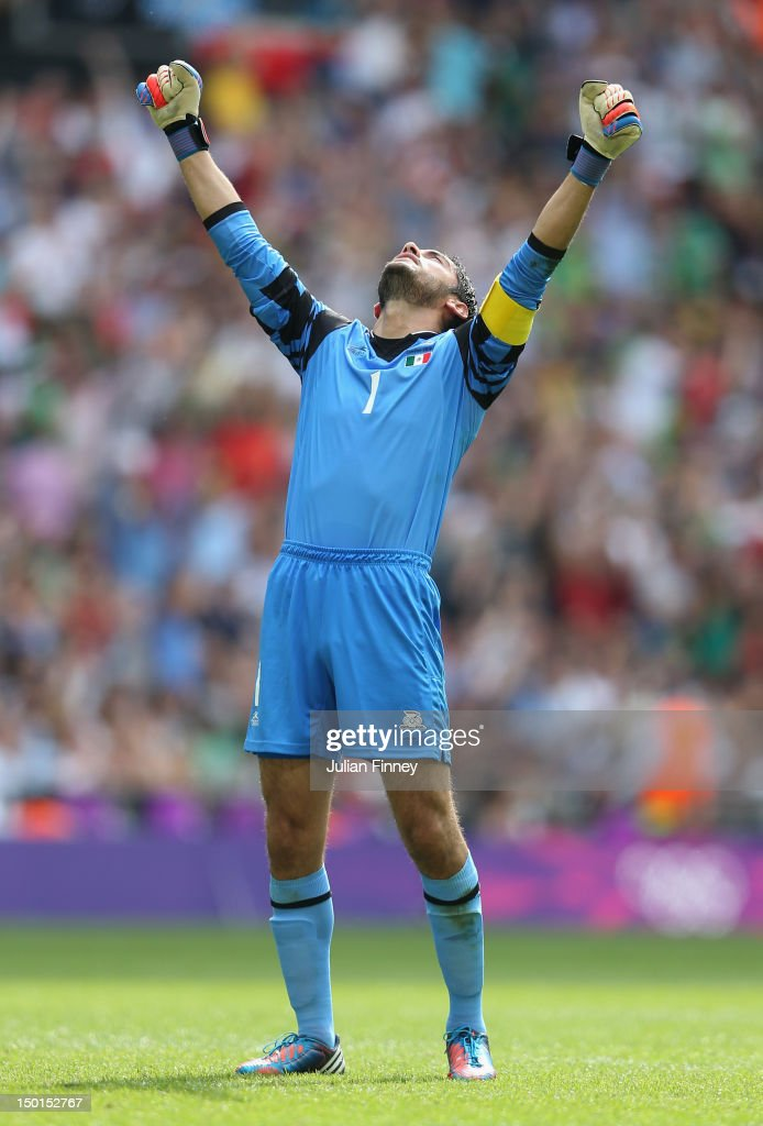 Jose Corona of Mexico celebrates as team-mate Oribe Peralta of Mexico scores their second goal during the Men's Football Final between Brazil and Mexico on Day 15 of the London 2012 Olympic Games at Wembley Stadium on August 11, 2012 in London, England.