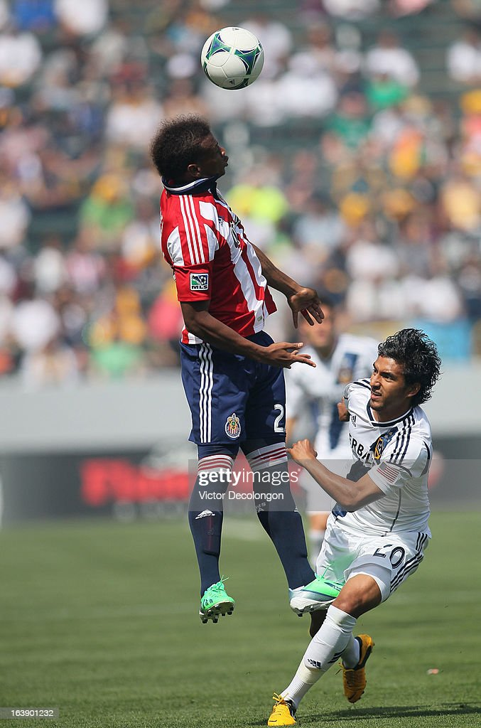 Jose Correa #27 of Chivas USA jumps for the high ball over A.J. DeLaGarza #20 of the Los Angeles Galaxy during their MLS match at The Home Depot Center on March 17, 2013 in Carson, California. Chivas USA and the Los Angeles Galaxy played to a 1-1 draw.