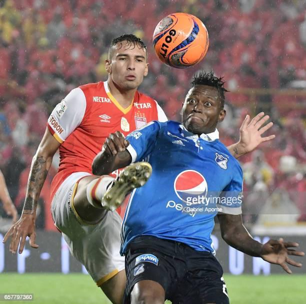 Jose David Moya of Santa Fe struggles for the ball with Duvier Riascos of Millonarios during the match between Santa Fe and Millonarios as part of...