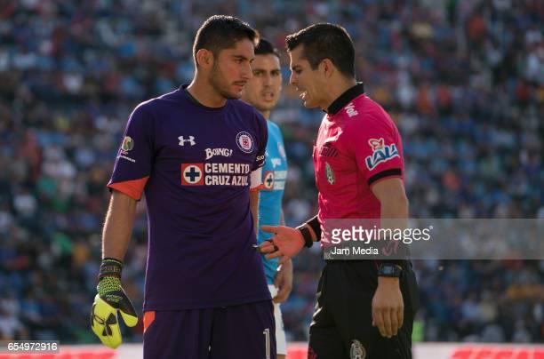 Jose de Jesus Corona of Cruz Azul and referee Fernando Hernandez Gomez talk during the 11th round match between Cruz Azul and Tigres UANL as part of...