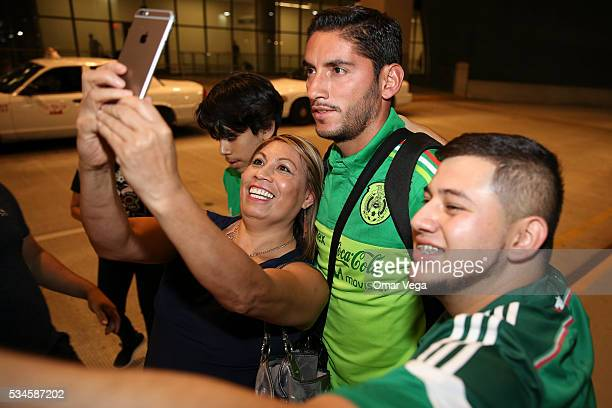 Jose de Jesus Corona of Mexico poses with a fan during the Mexico National Team arrival to United States at HartsfieldJackson International Airport...