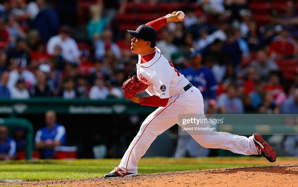 Jose De La Torre #65 of the Boston Red Sox pitches against the Toronto Blue Jays during the game on May 12, 2013 at Fenway Park in Boston, Massachusetts.