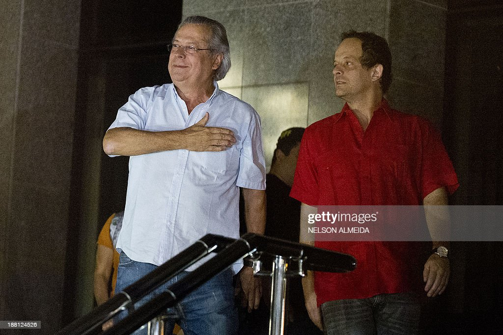 Jose Dirceu (L), former Chief of Staff of President Luiz Inacio Lula da Silva accused in the Mensalao scandal, arrives at the headquarters of the Federal Police in Sao Paulo, Brazil on November 15, 2013.