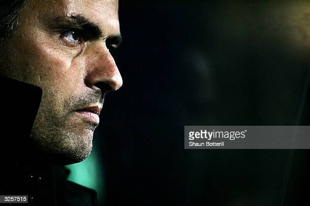 Jose Dos Santos Mournho the Porto coach looks out from the dugout before the second goal during the UEFA Champions League Quarter Final Second Leg...