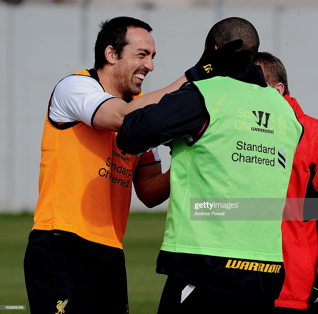Jose Enrique and <a gi-track='captionPersonalityLinkClicked' href=/galleries/search?phrase=Glen+Johnson&family=editorial&specificpeople=209192 ng-click='$event.stopPropagation()'>Glen Johnson</a> of Liverpool in action during a training session at Melwood Training Ground on March 14, 2013 in Liverpool, England.