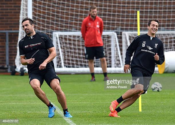 Jose Enrique and Javier Manquillo of Liverpool in action during a training session at at Melwood Training Ground on August 29 2014 in Liverpool...