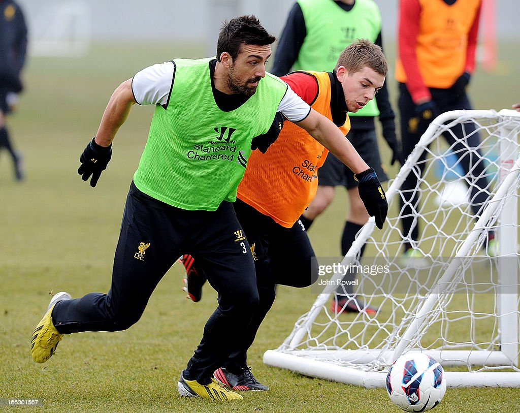 Jose Enrique and Jon Flanagan of Liverpool in action during a training session at Melwood Training Ground on April 11, 2013 in Liverpool, England.