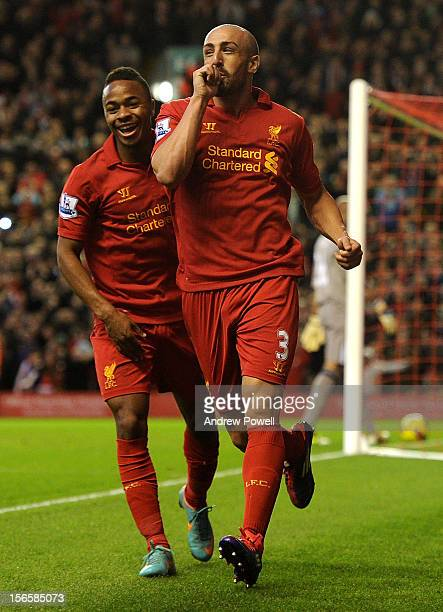 Jose Enrique of Liverpool celebrates his goal with Raheem Sterling during the Barclays Premier League match between Liverpool and Wigan Athletic at...