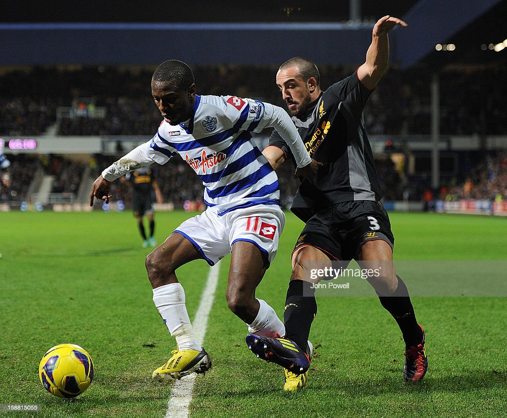 Jose Enrique of Liverpool competes wioth Shaun Wright-Phillips of Queens Park Rangers during the Barclays Premier League match between Queens Park Rangers and Liverpool at Loftus Road on December 30, 2012 in London, England.