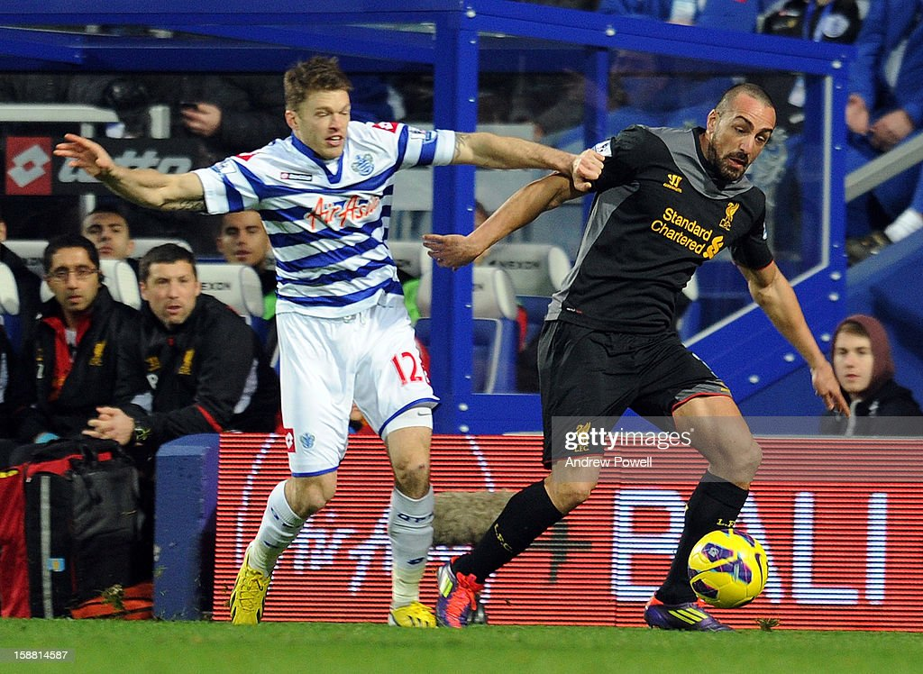 Jose Enrique of Liverpool competes with Jamie Mackie of Queens Park Rangers during the Barclays Premier League match between Queens Park Rangers and Liverpool at Loftus Road on December 30, 2012 in London, England.