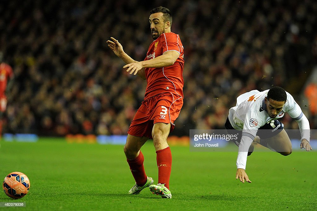 Jose Enrique of Liverpool competes with Liam Feeney of Bolton Wanderers during the FA Cup Fourth Round match between Liverpool and Bolton Wanderers...
