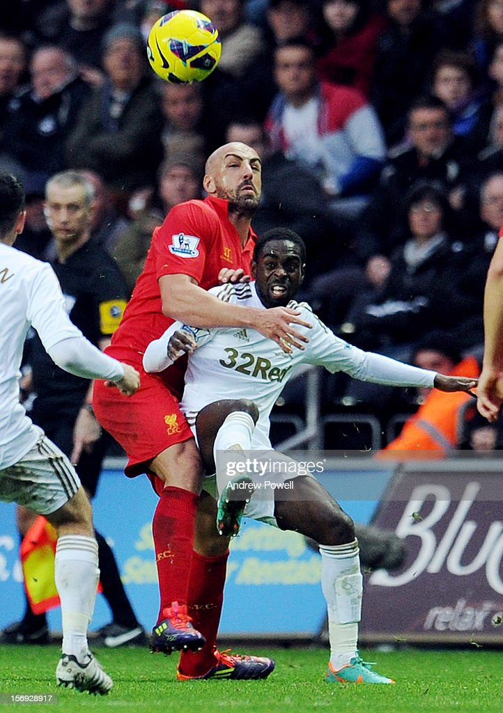 Jose Enrique of Liverpool competes with Nathan Dyer of Swansea City during the Barclays Premier League match between Swansea City and Liverpool at Liberty Stadium on November 25, 2012 in Swansea, Wales.