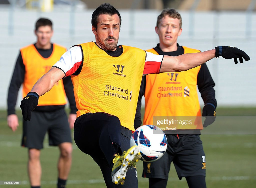 Jose Enrique (L) of Liverpool FC with Lucas during a training session.at Melwood Training Ground on February 28, 2013 in Liverpool, England.