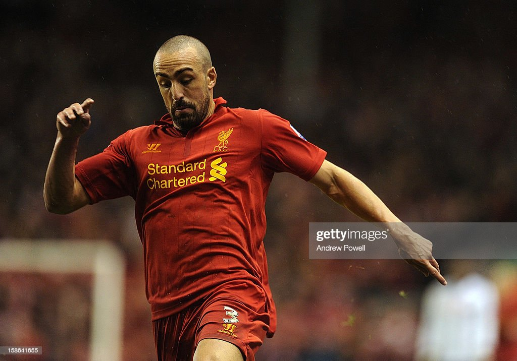 Jose Enrique of Liverpool in action during the Barclays Premier League match between liverpool and Fulham at Anfield on December 22, 2012 in Liverpool, England.