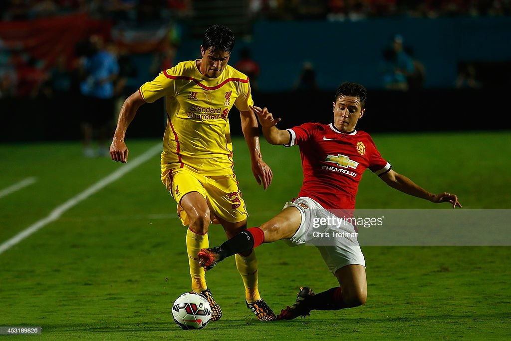 Jose Enrique #3 of Liverpool is challenged by (R) Ander Herrera #21 of Manchester United in the Guinness International Champions Cup 2014 Final at Sun Life Stadium on August 4, 2014 in Miami Gardens, Florida.