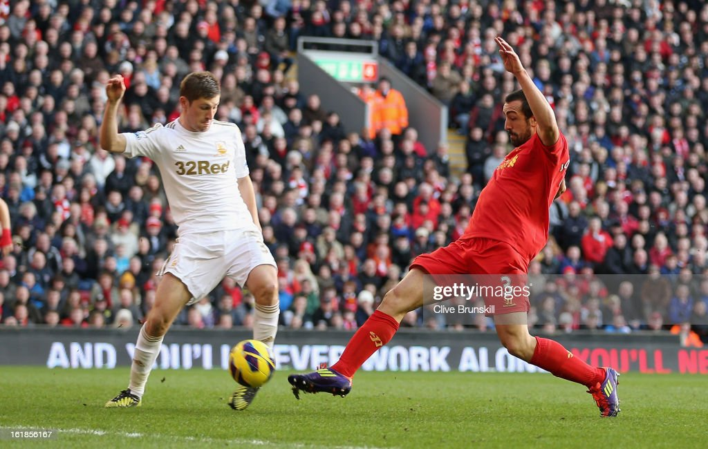 Jose Enrique of Liverpool scores the third goal during the Barclays Premier League match between Liverpool and Swansea City at Anfield on February 17, 2013 in Liverpool, England.