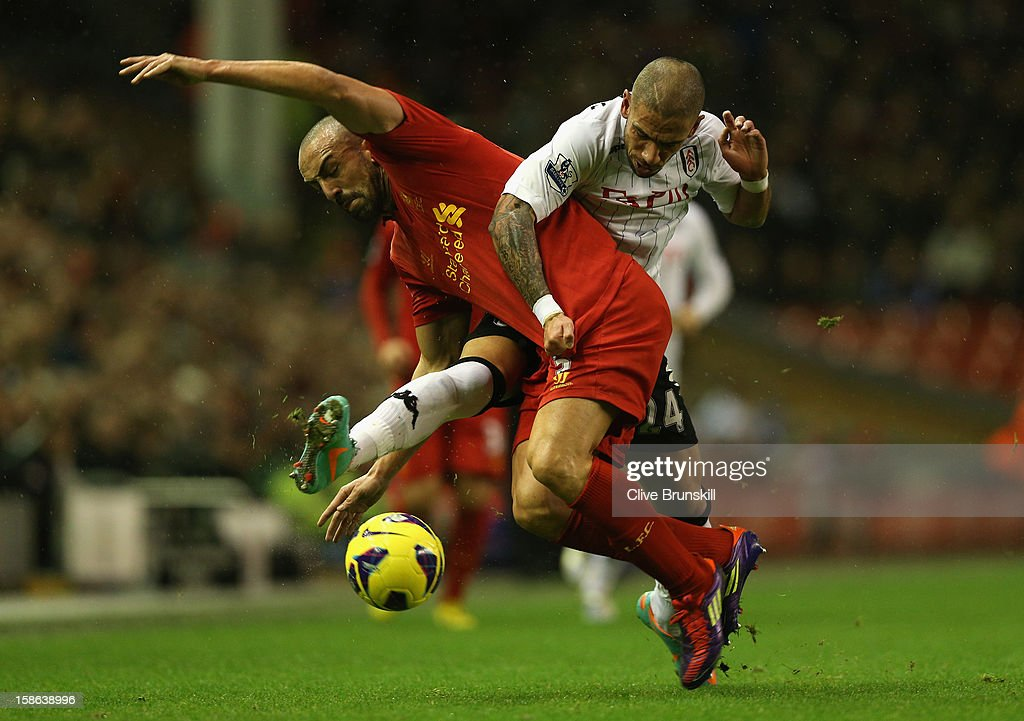 Jose Enrique of Liverpool tangles with <a gi-track='captionPersonalityLinkClicked' href=/galleries/search?phrase=Ashkan+Dejagah&family=editorial&specificpeople=4024305 ng-click='$event.stopPropagation()'>Ashkan Dejagah</a> of Fulham during the Barclays Premier League match between Liverpool and Fulham at Anfield on December 22, 2012 in Liverpool, England.