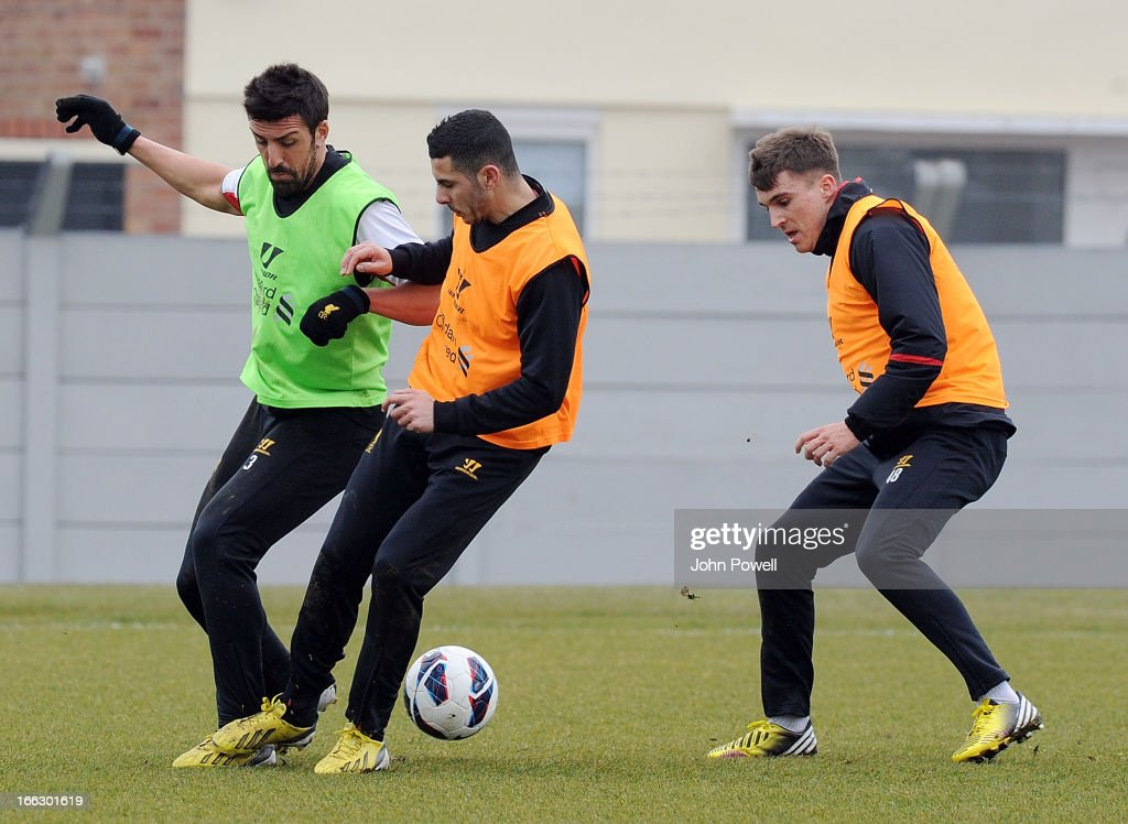 Jose Enrique, Oussama Assaidi and Adam Morgan of Liverpool in action during a training session at Melwood Training Ground on April 11, 2013 in Liverpool, England.