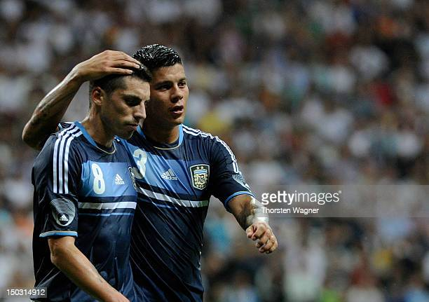 Jose Ernesto da Sosa and his team mate Faustino Marcos Alberto Rojo of Argentina celebrates after Sami Khedira is scoring the 10 with a own goal...