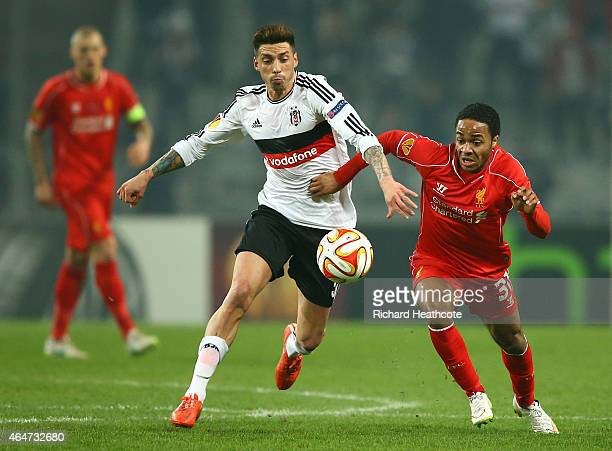 Jose Ernesto Sosa of Besiktas battles with Raheem Sterling of Liverpool during the 2nd leg of the UEFA Europa League Round of 32 match between...