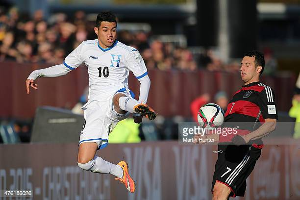 Jose Escalante of Honduras controls the ball from Levin Oeztunali of Germany during the FIFA U20 World Cup New Zealand 2015 Group F match between...