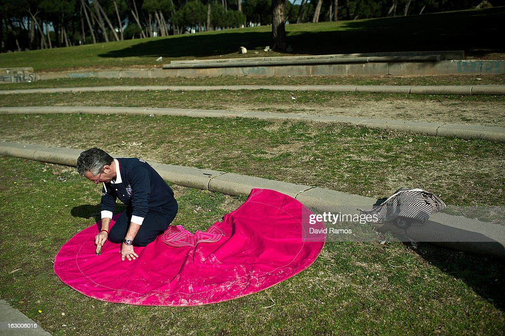 Jose Fernandez brushes his cape before practicing bullfighting in a city park in Santa Perpetua de la Mogoda on March 3, 2013 in Barcelona, Spain. On February 12 the Spanish Parliament accepted a petition from bullfight supporters asking for the sport to become a key part of the Spain's cultural heritage. The petition, of 590,000 signatures, has been promoted by the Federation of Bullfighting Entities of Catalonia. The last bullfight in Catalonia was held in September 25, 2011.