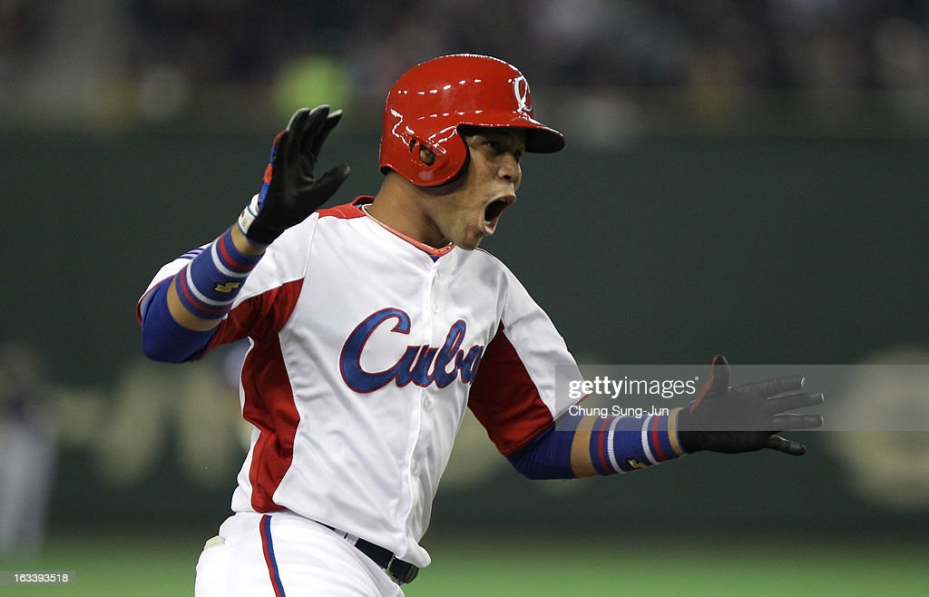 Jose Fernandez # 8 of Cuba celebrates after Frederich Cepeda's two run home run bottom in the first inning during the World Baseball Classic Second Round Pool 1 game between Chinese Taipei and Cuba at Tokyo Dome on March 9, 2013 in Tokyo, Japan.