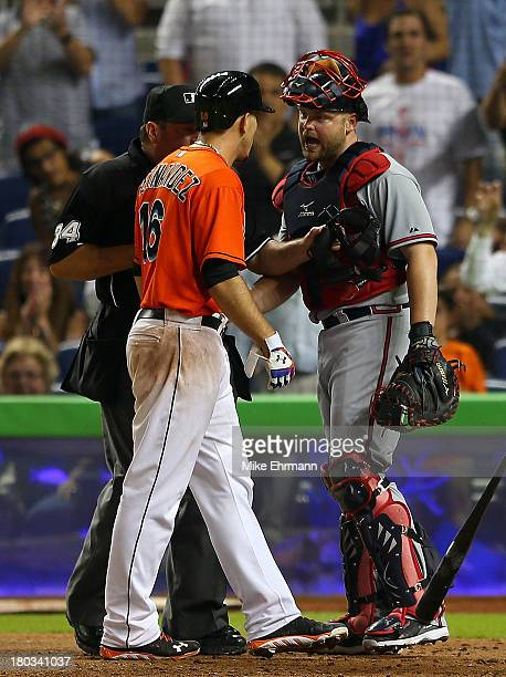 Jose Fernandez of the Miami Marlins and Brian McCann of the Atlanta Braves have words after a solo home run by Fernandez in the sixth inning during a...