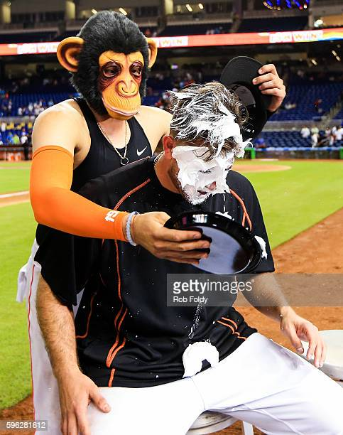 Jose Fernandez of the Miami Marlins gets shaving cream smeared on his face by Miguel Rojas of the Miami Marlins after the game against the Kansas...