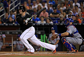 Jose Fernandez of the Miami Marlins hits an RBI single during a game against the New York Mets at Marlins Park on July 23 2016 in Miami Florida