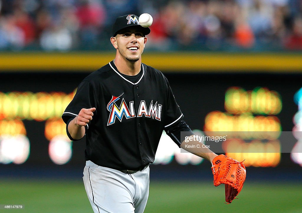 Jose Fernandez of the Miami Marlins reacts after getting called for a balk as BJ Upton of the Atlanta Braves advances to second base in the fourth...