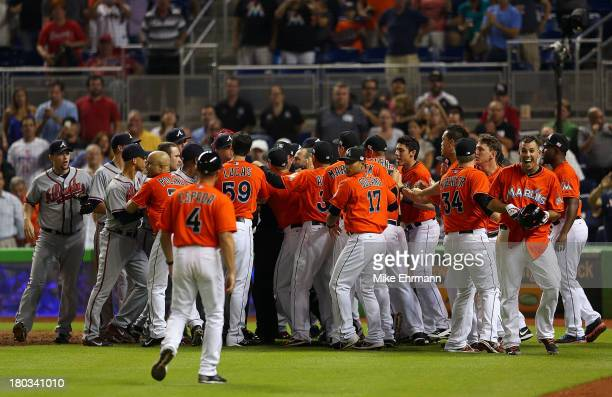 Jose Fernandez of the Miami Marlins reacts to a fight after he hit a solo home run in the sixth inning during a game against the Atlanta Braves at...