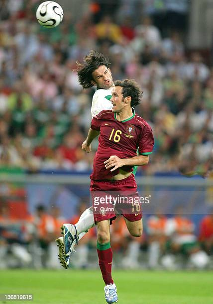 Jose Fonseca beats Ricardo Carvalho to a header during the Group D match between Portugal and Mexico at FIFA World Cup stadium Gelsenkirchen Germany...