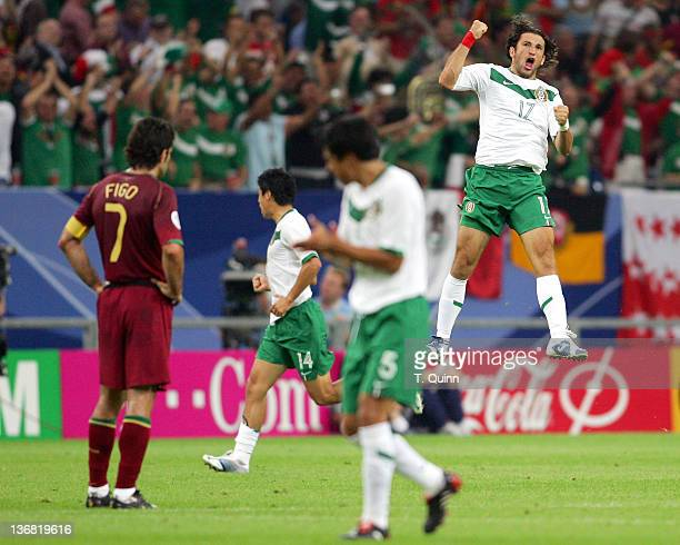 Jose Fonseca celebrates scoring for Mexico during the Group D match between Portugal and Mexico at FIFA World Cup stadium Gelsenkirchen Germany on...