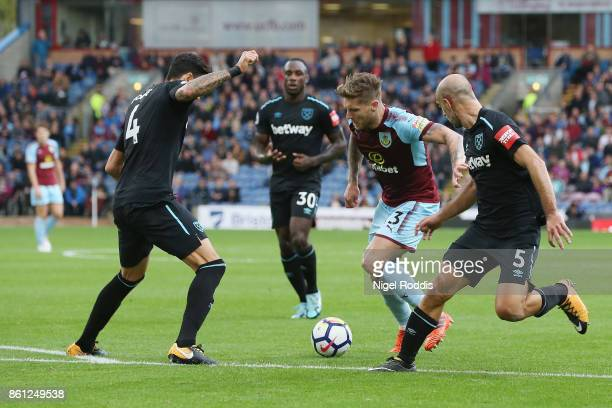 Jose Fonte and Pablo Zabaleta of West Ham United close down Charlie Taylor of Burnley during the Premier League match between Burnley and West Ham...