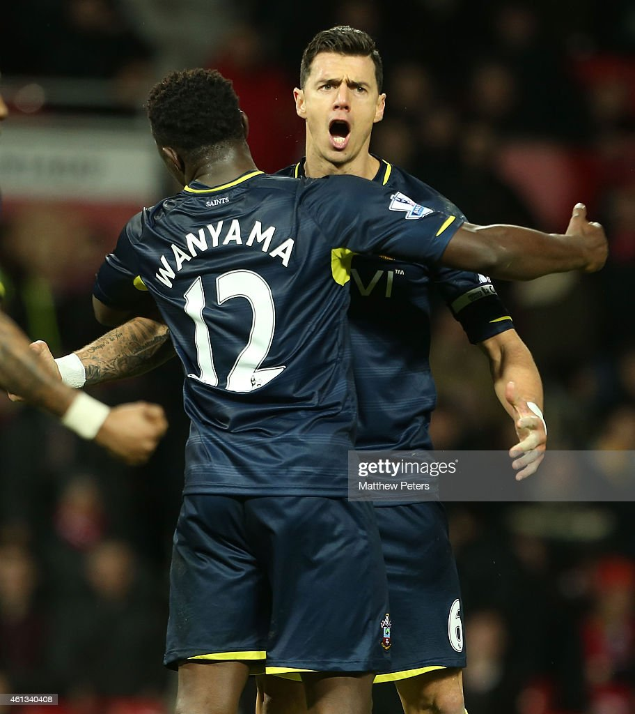 Jose Fonte and <a gi-track='captionPersonalityLinkClicked' href=/galleries/search?phrase=Victor+Wanyama&family=editorial&specificpeople=7126412 ng-click='$event.stopPropagation()'>Victor Wanyama</a> of Southampton celebrate after the Barclays Premier League match between Manchester United and Southampton at Old Trafford on January 11, 2015 in Manchester, England.