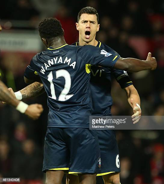 Jose Fonte and Victor Wanyama of Southampton celebrate after the Barclays Premier League match between Manchester United and Southampton at Old...