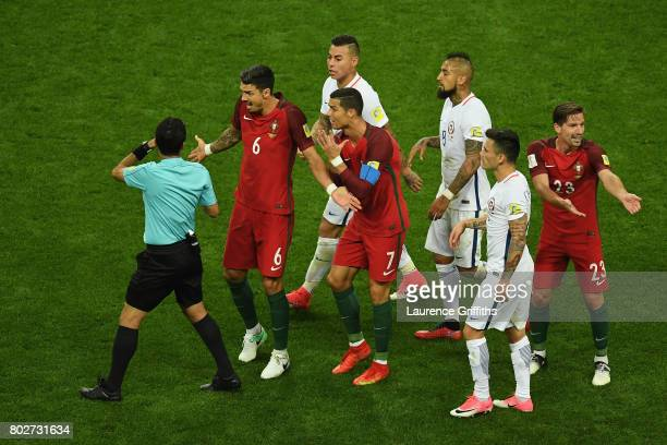 Jose Fonte of Portugal and Cristiano Ronaldo of Portugal argues with Referee Alireza Faghani during the FIFA Confederations Cup Russia 2017 SemiFinal...
