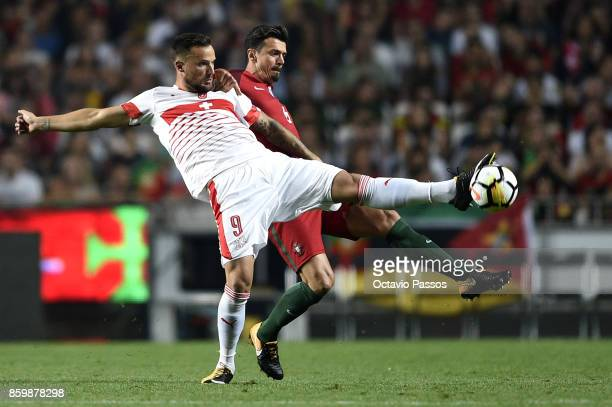 Jose Fonte of Portugal competes for the ball with Haris Seferovic of Switzerland during the FIFA 2018 World Cup Qualifier between Portugal and...