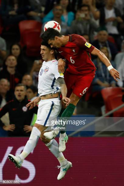 Jose Fonte of Portugal national team and Pablo Hernandez of Chile national team vie for a header during FIFA Confederations Cup Russia 2017 semifinal...