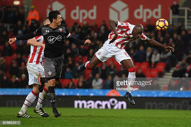 Jose Fonte of Southampton and Bruno Martins Indi of Stoke City battel to win a header during the Premier League match between Stoke City and...