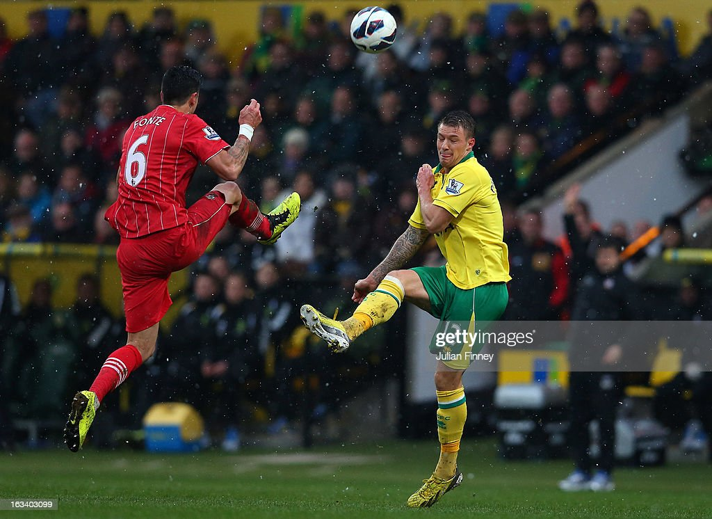Jose Fonte of Southampton battles with Anthony Pilkington of Norwich City during the Barclays Premier League match between Norwich City and Southampton at Carrow Road on March 9, 2013 in Norwich, England.