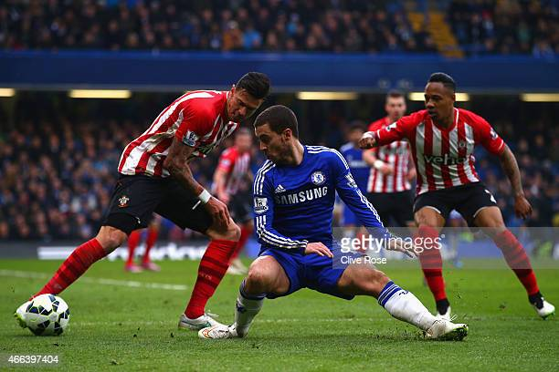 Jose Fonte of Southampton challenges Eden Hazard of Chelsea during the Barclays Premier League match between Chelsea and Southampton at Stamford...