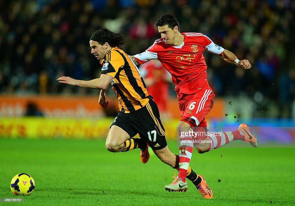 Jose Fonte of Southampton challenges George Boyd of Hull City during the Barclays Premier League match between Hull City and Southampton at the KC Stadium on February 11, 2014 in Hull, England.