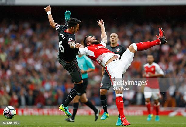 Jose Fonte of Southampton fouls Olivier Giroud of Arsenal in the box during the Premier League match between Arsenal and Southampton at Emirates...