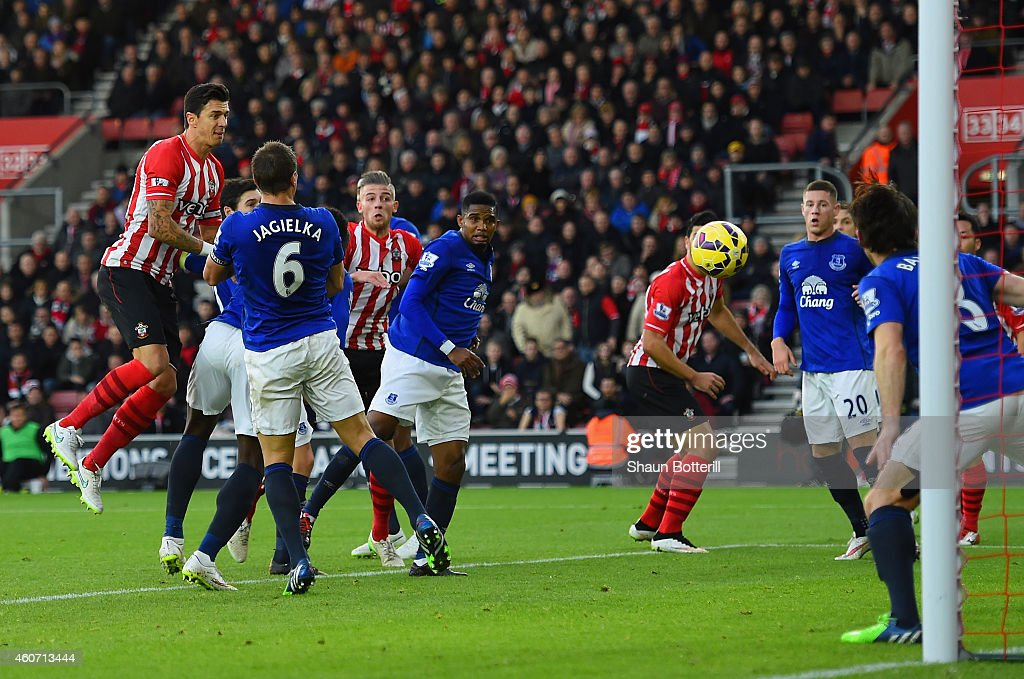 Jose Fonte of Southampton heads towards goal and his effort is deflected in by Romelu Lukaku of Everton during the Barclays Premier League match between Southampton and Everton at St Mary's Stadium on December 20, 2014 in Southampton, England.